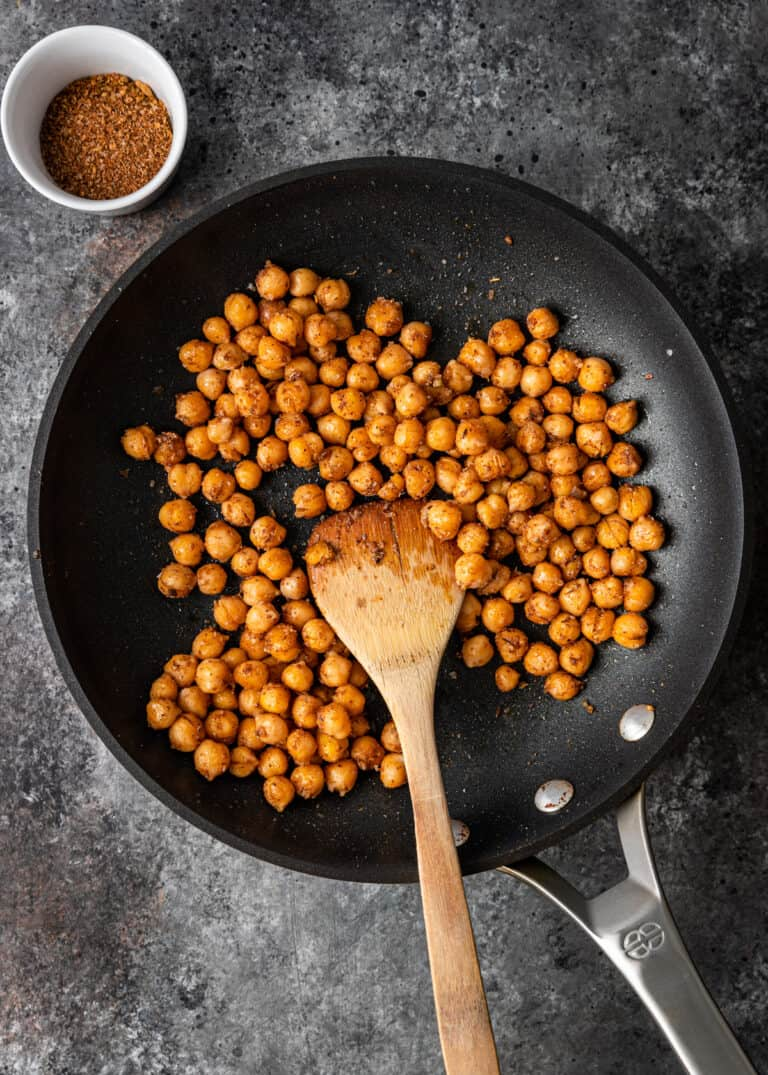 overhead: toasting garbanzo beans in skillet for mediterranean pizza