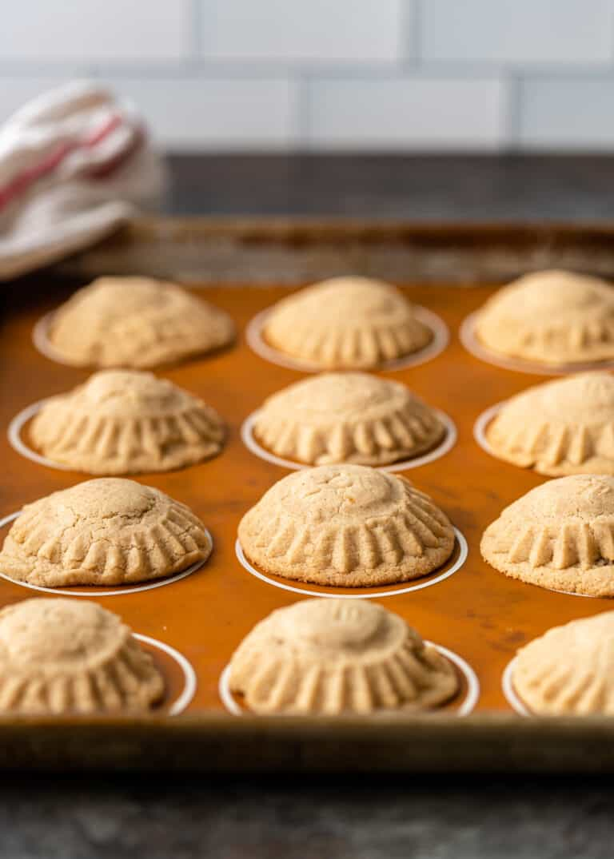 buttery semolina cookies cooling on baking pan