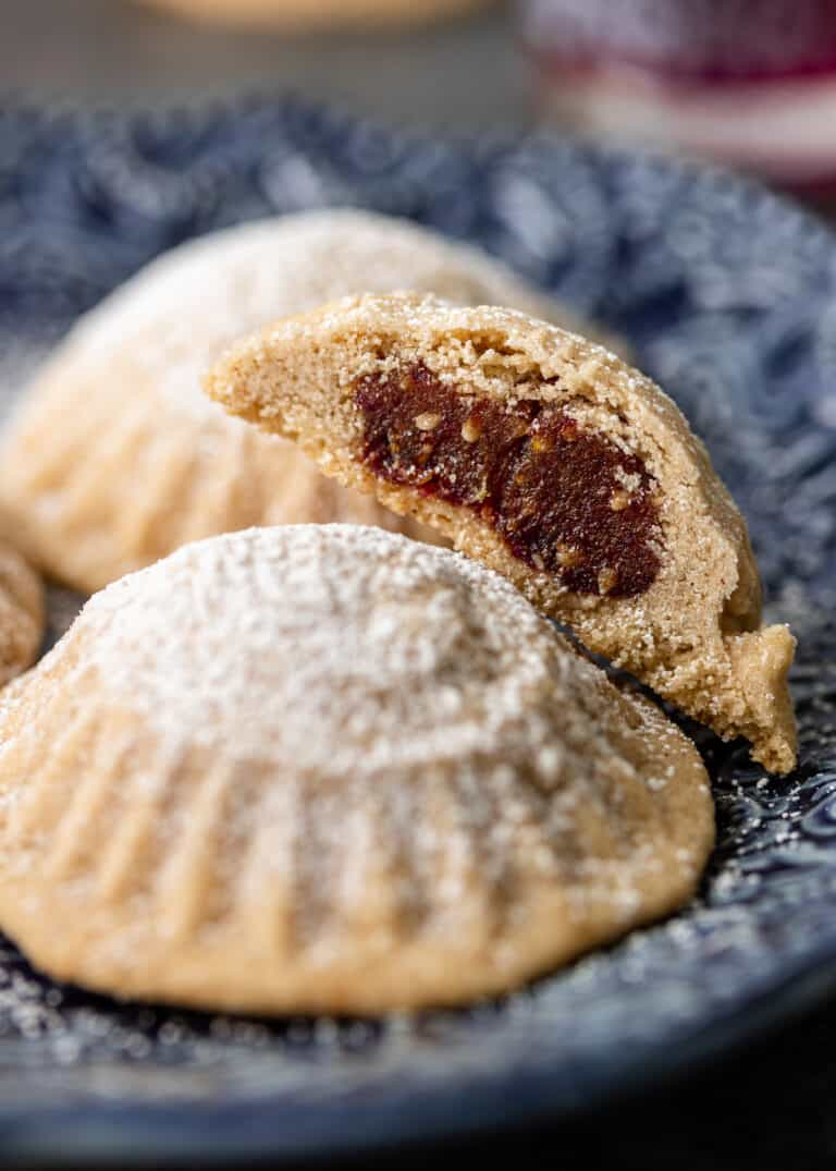 close up image: plate of semolina cookies with date filling