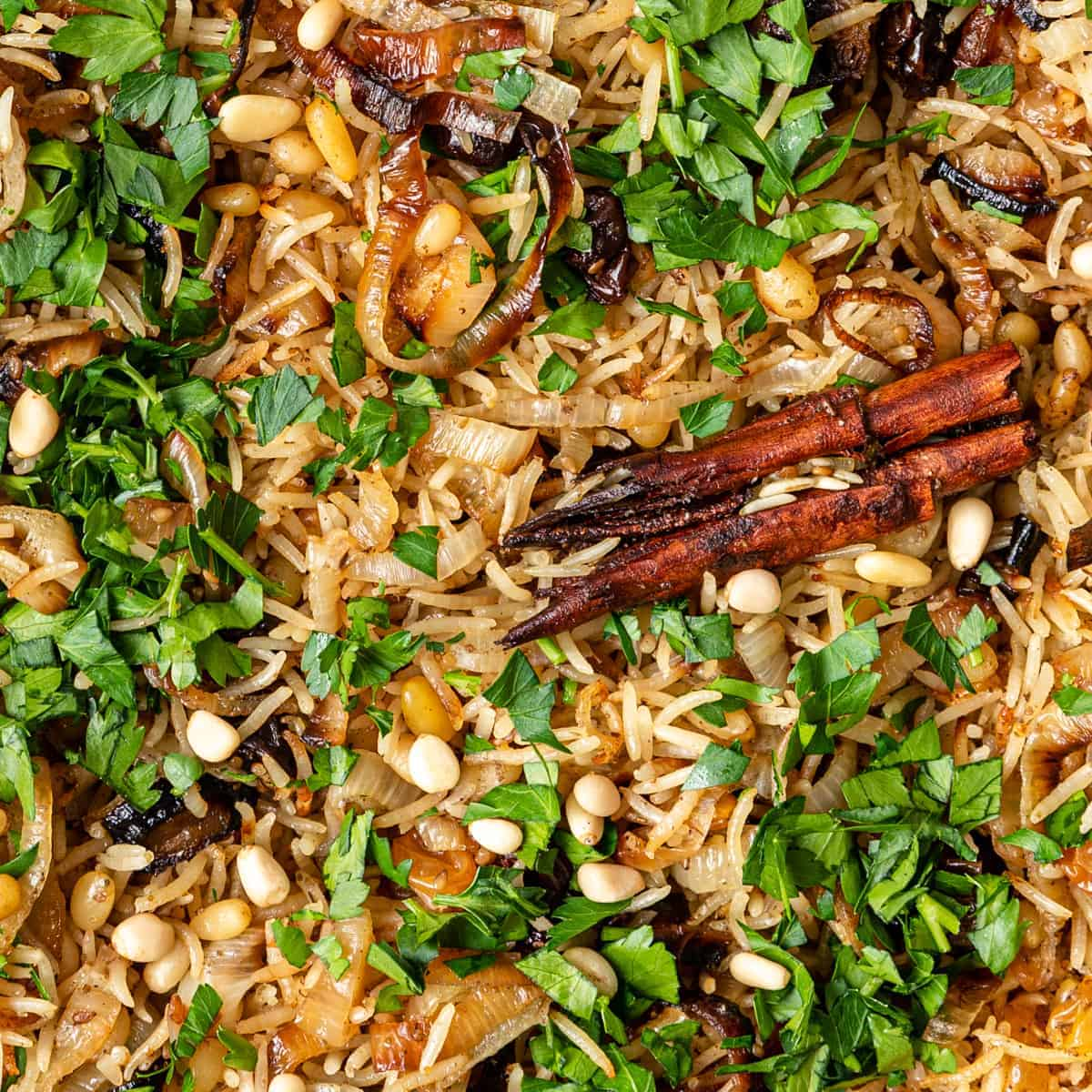 close up of herbs and spices in baked basmati rice