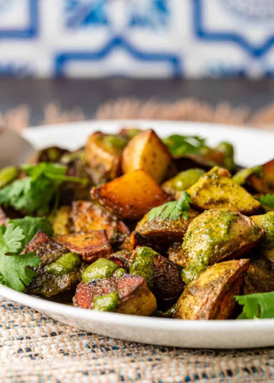 spicy batata harra on white serving platter