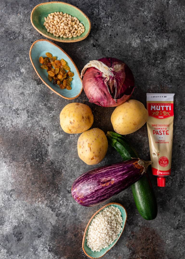 overhead: eggplant, yellow potatoes, onion and greek spices for gemista