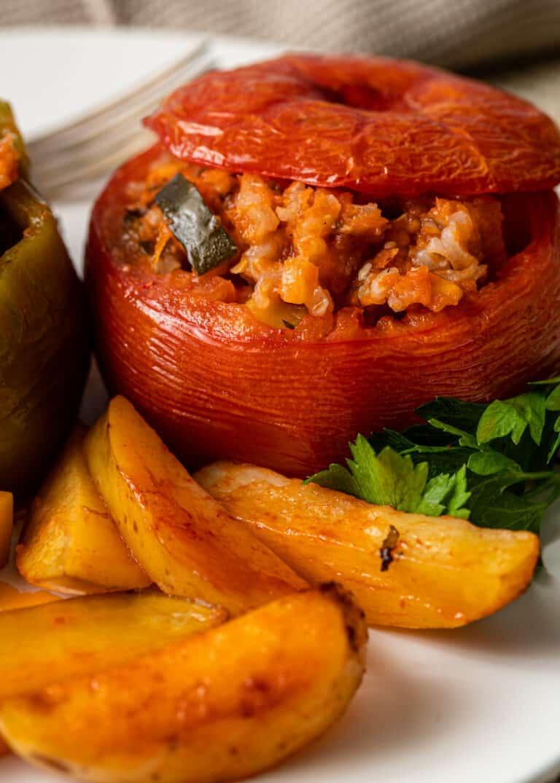 close up of greek stuffed tomatoes
