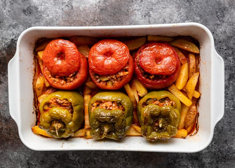 overhead image of gemista (greek stuffed peppers and tomatoes)