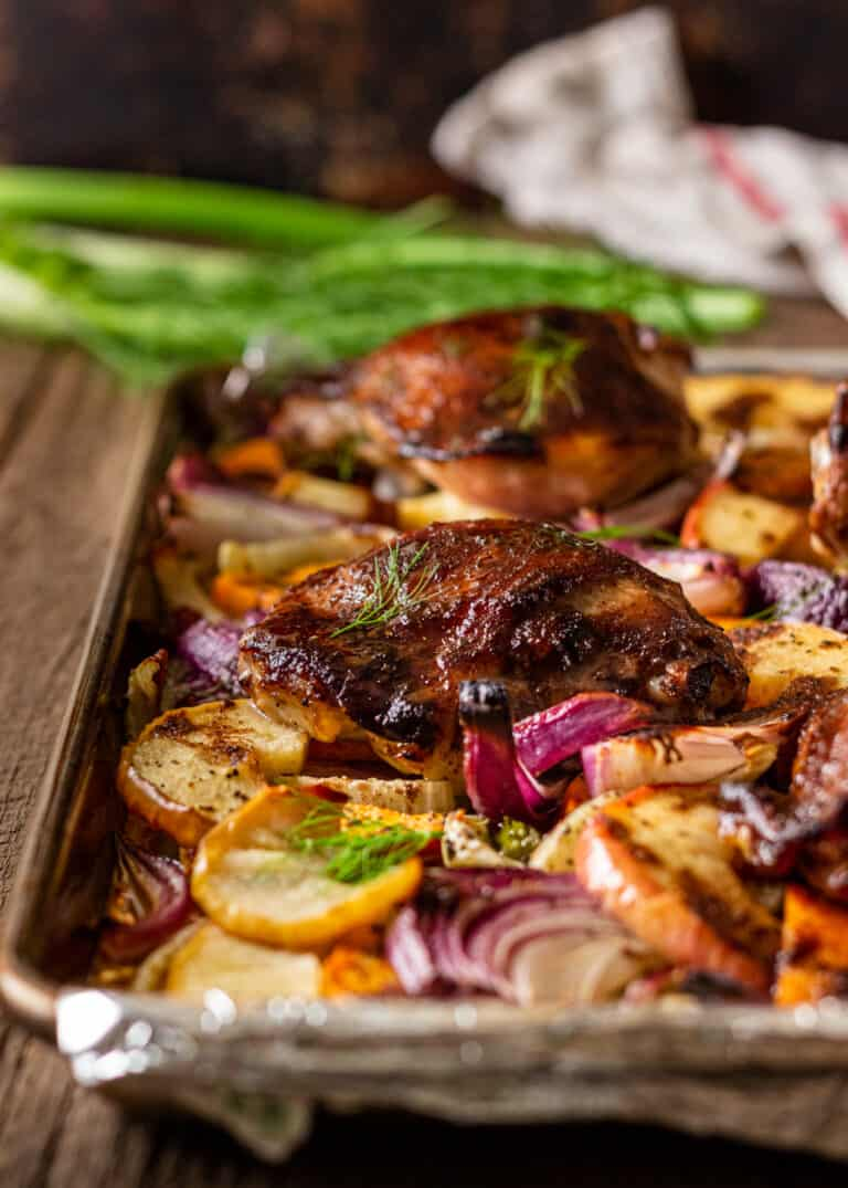 chinese roast chicken and vegetables cooking on sheet pan